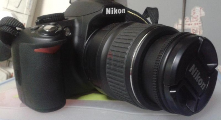 Nikon D3100 Camera with 18-55mm lens and tripod stand  –  AED 1,500