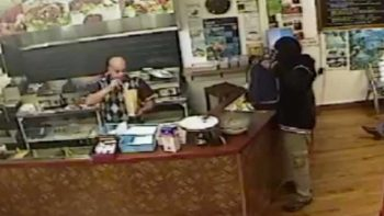 Bizarre robbery ever? Shop owner held at gunpoint does unexpected