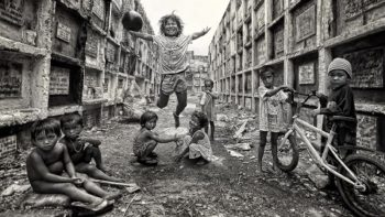 Photo of children at Manila cemetery wins HIPA photo contest