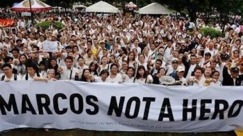 15,000 brave rain to protest Marcos burial