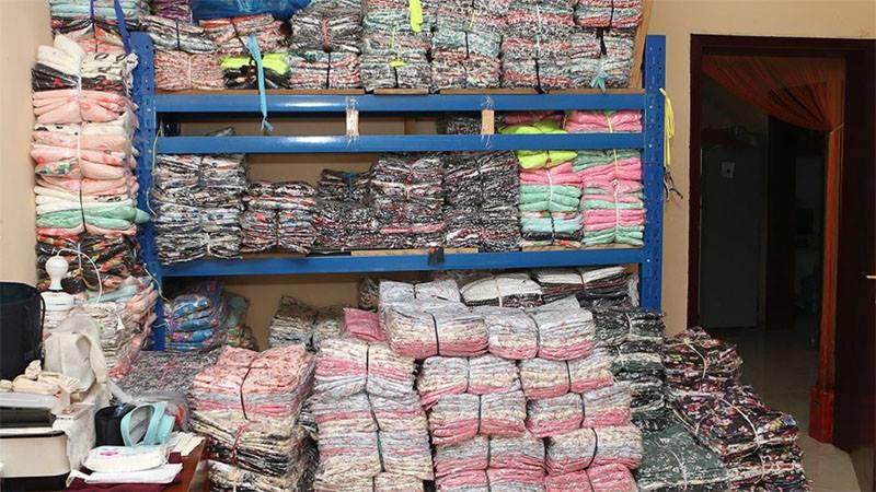 Counterfeit items found in a villa in Ajman. AJMAN POLICE