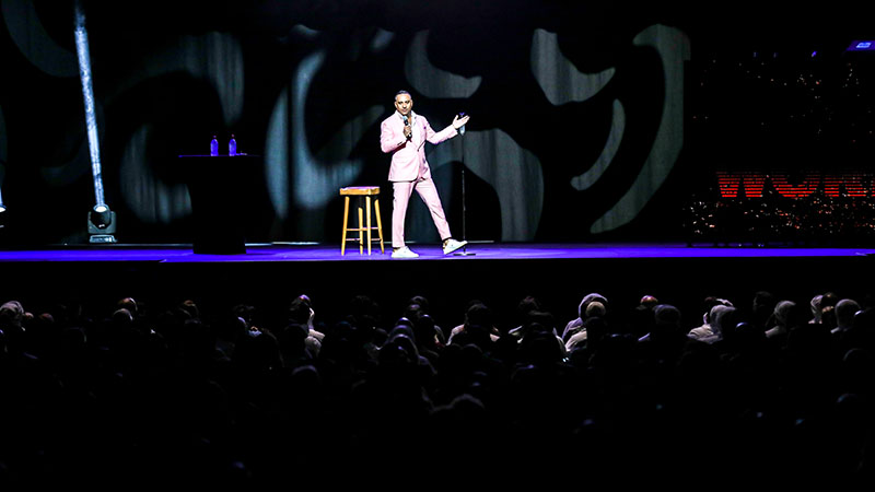 ComedianRussell Peters performs at the Coca-Cola Arena on June 6, 2019.