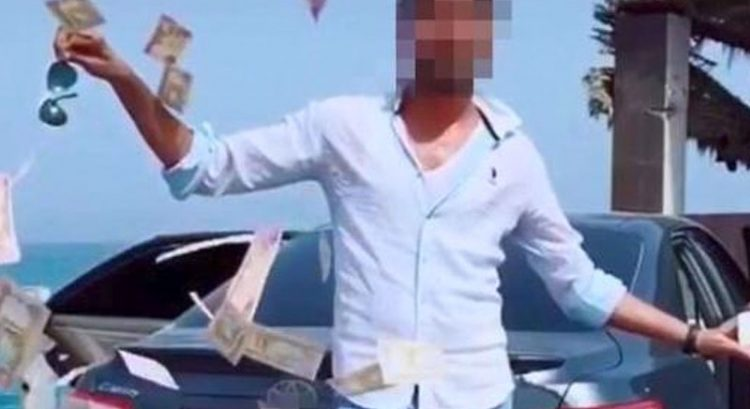 Man arrested in Dubai for throwing cash in stunt