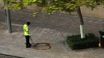 Dubai street cleaner who drew heart on pavement becomes Instagram sensation