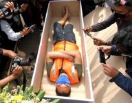 Indonesia's face mask violators told to lay in coffin